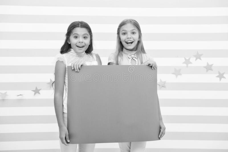Girls kids hold advertisement poster copy space. Children hold advertising banner. Happy children with blank paper for. Advertisement. Advertisement concept royalty free stock images