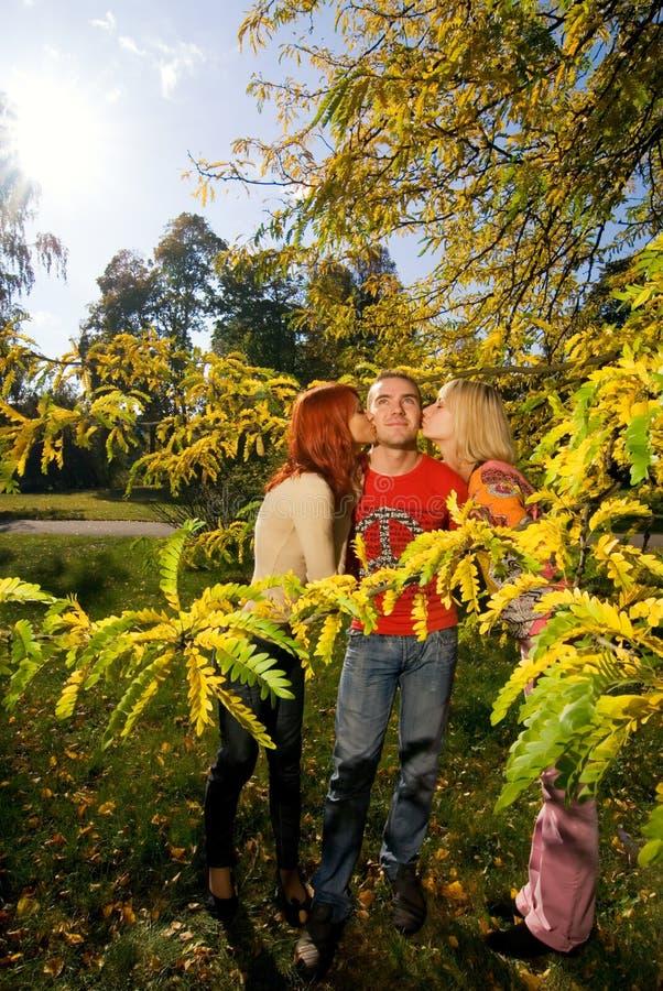Girls Kissing One Guy Stock Images Image 3941914