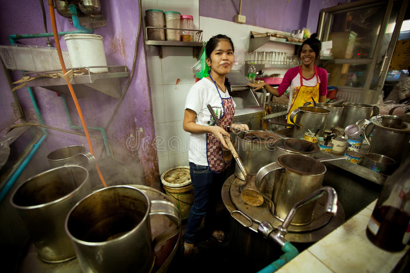 Download Girls From Lao Working On The Kitchen Editorial Image - Image: 23933235