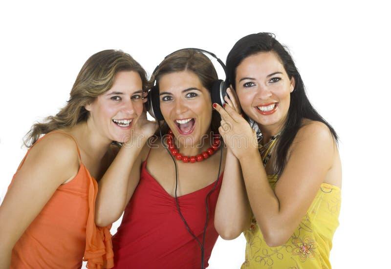 Girls listening music stock photos
