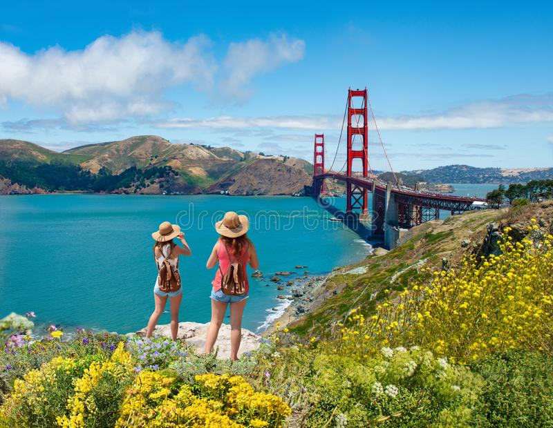 Girls looking at beautiful view of Golden Gate Bridge. stock image