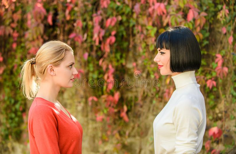 Girls looking into each others eyes. female friendship. best friends. chance meeting. Friendship forever. Portrait of royalty free stock photography