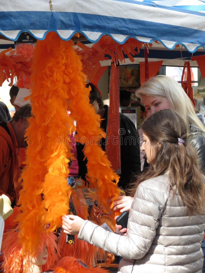Download Amsterdam, Girls Looking At An Orange Feather Boa Editorial Stock Photo - Image: 30714593