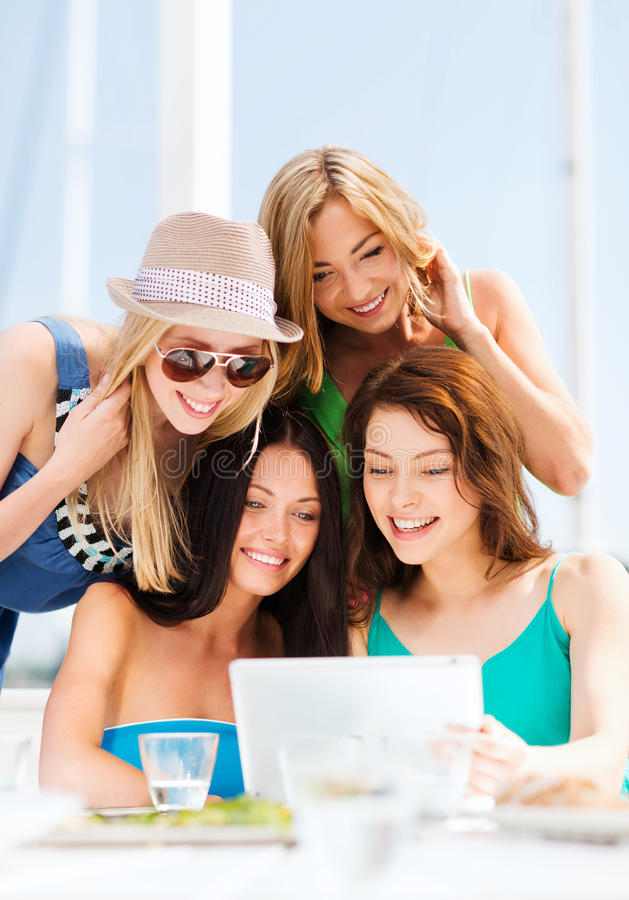 Download Girls Looking At Tablet Pc In Cafe Royalty Free Stock Images - Image: 33187769