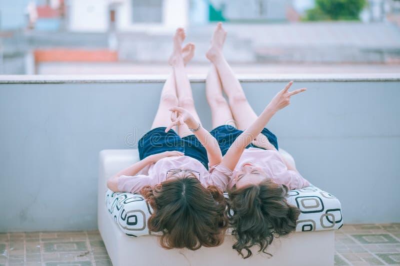 Girls lying down stock photo