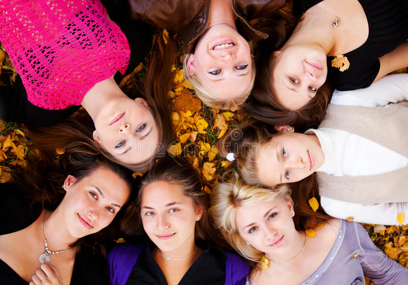 Girls lying on the grass. Young beautiful girls lying on the grass stock images