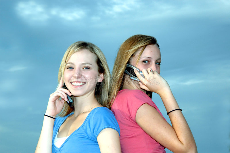 Download Girls making calls stock image. Image of cell, teen, teenager - 1376305