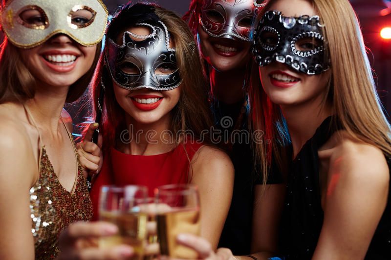 Girls in masks royalty free stock image
