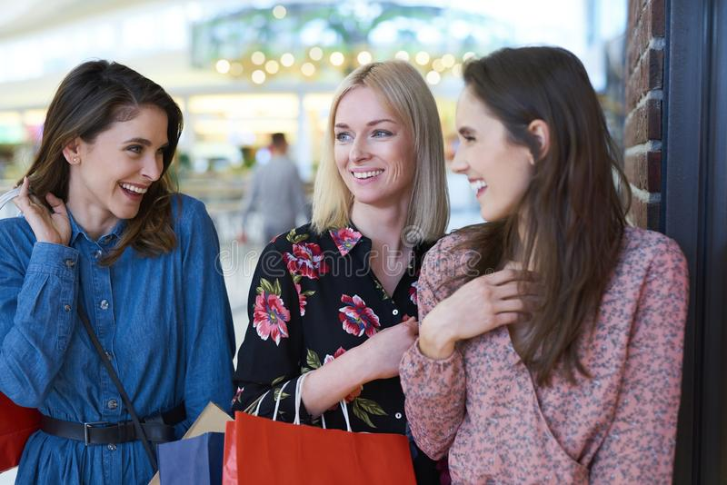 Girls meeting at the shopping mall royalty free stock image