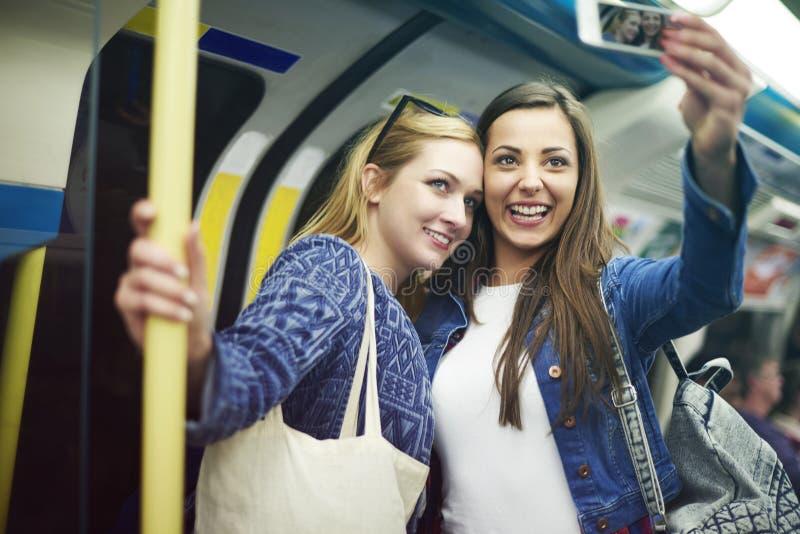 Girls in metro stock photos