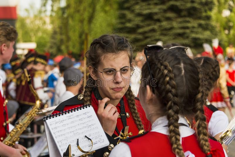 Girls-musicians talk before the performance. Lviv , Ukraine - May 05 2018: Celebratory events on the occasion of the city day. Performance of children`s music stock image