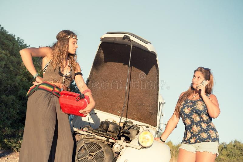 Girls near a car with no fuel. royalty free stock image