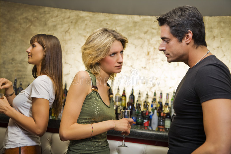 Girls night out. Guy breaking up with his girlfriend royalty free stock photo