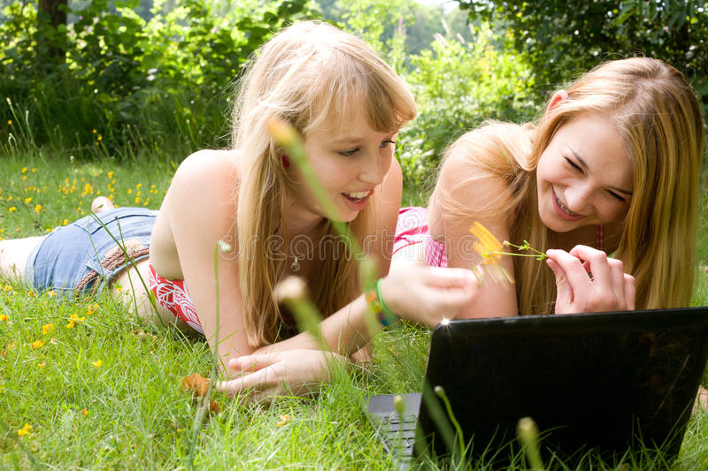 Download Girls and a notebook stock photo. Image of outdoors, children - 27975802