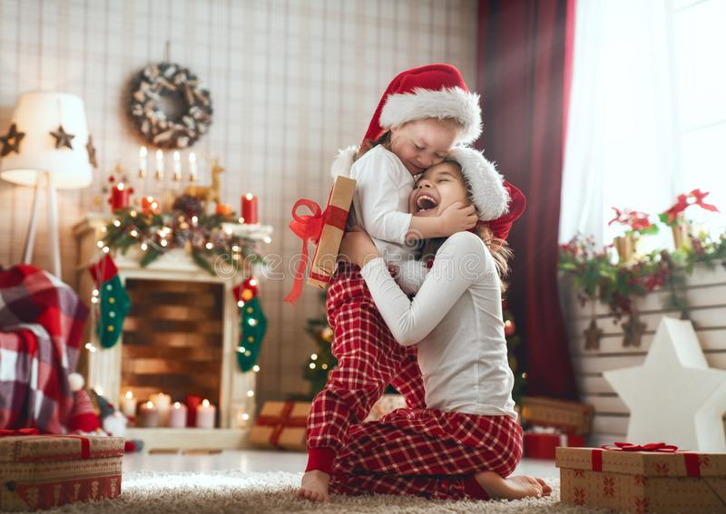 Girls opening Christmas gifts royalty free stock photography