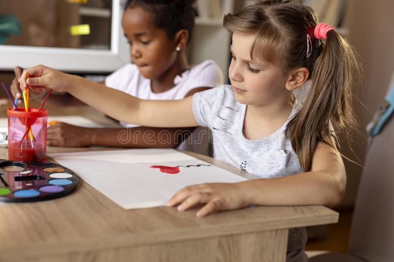 Girls painting with water colors stock photos