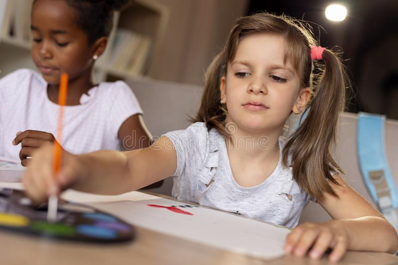 Girls painting with water colors royalty free stock photography