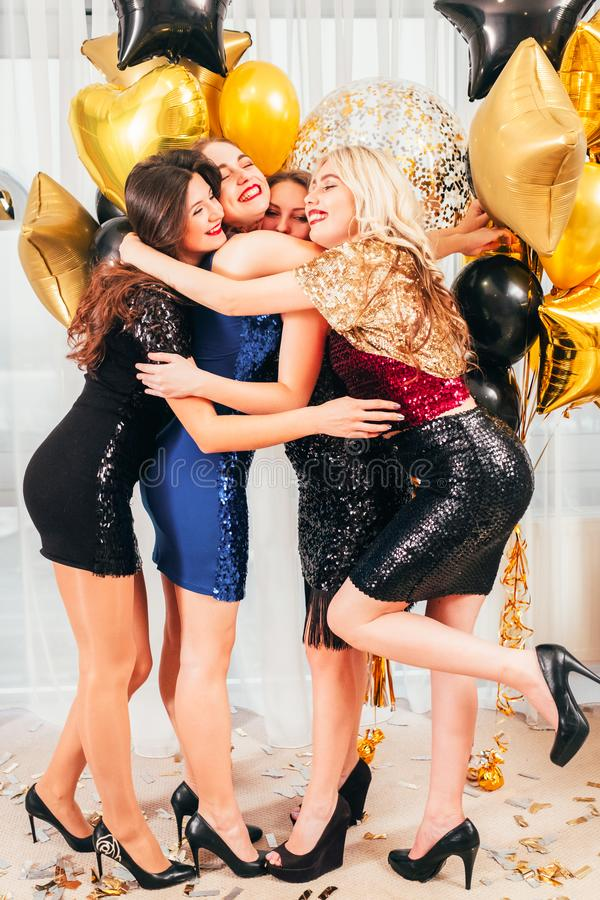 Girls party positive emotional hugging happy royalty free stock images