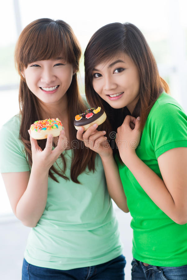 Download Girls with pastries stock image. Image of casual, content - 27007319