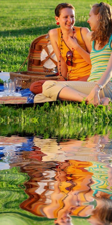 Girls on picnic royalty free stock photo