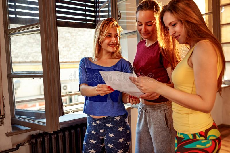 Girls planning choreography of hip hop dancers. Together stock photography