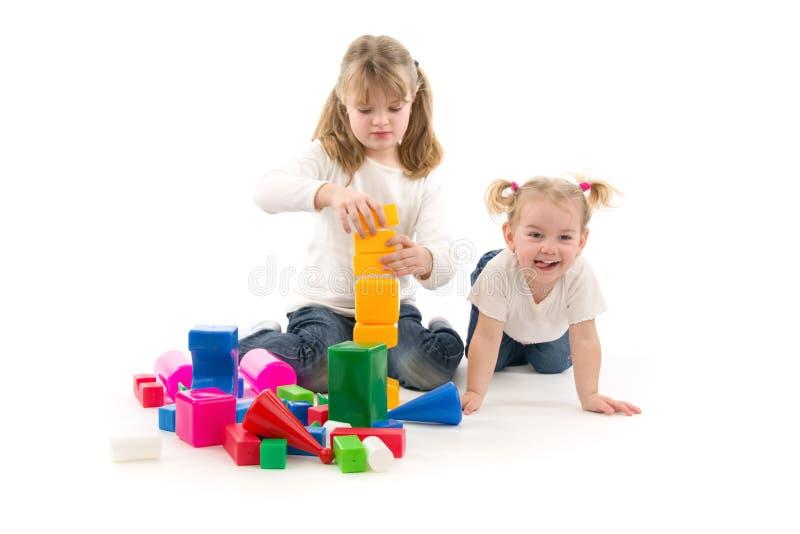 Girls play. On white background stock photos