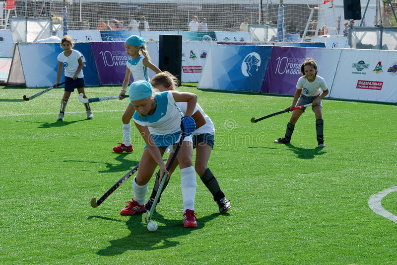 Girls play field hockey. MOSCOW, RUSSIA - AUGUST 7,2014:Girls play field hockey stock images