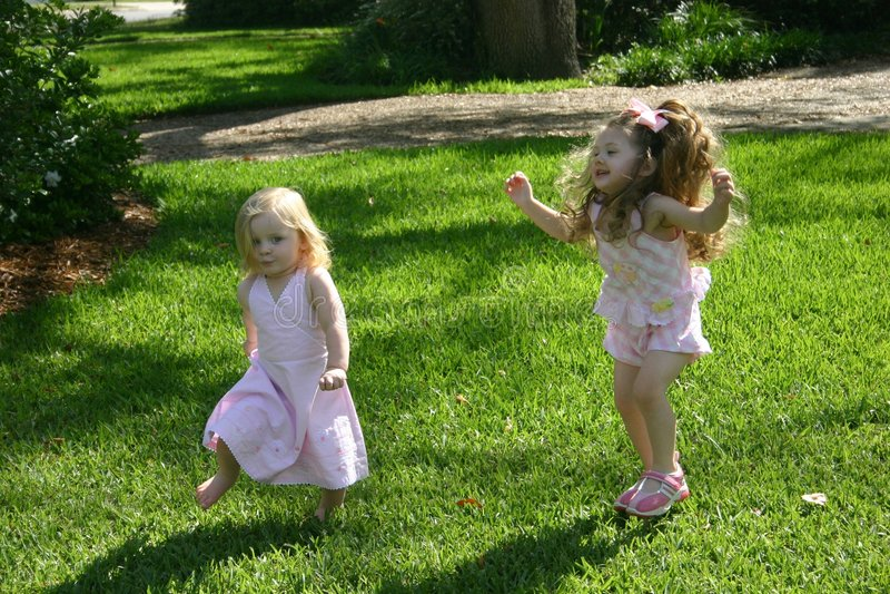 Girls Playing Chase stock image