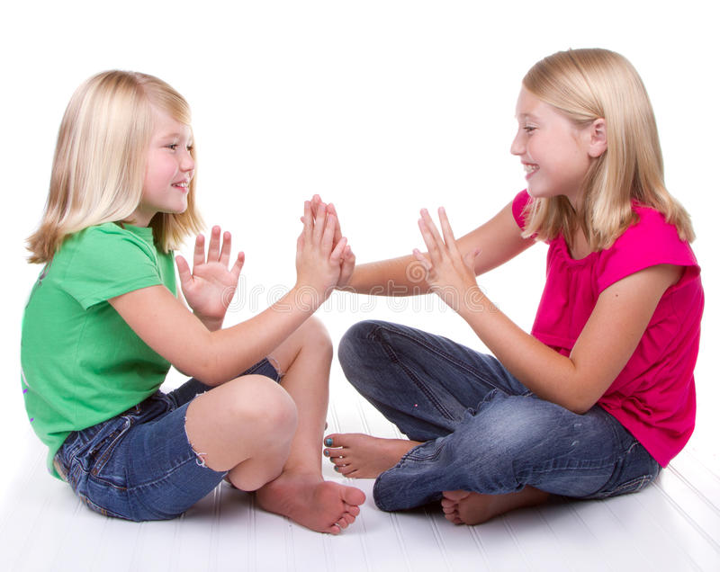 Girls Playing Clapping Game Stock Image