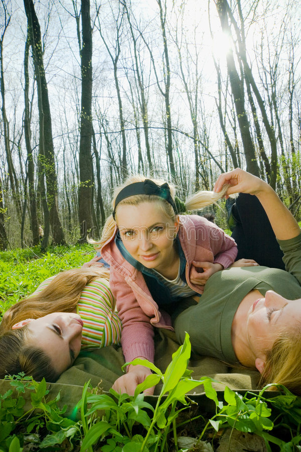 Girls playing in the forest stock photos