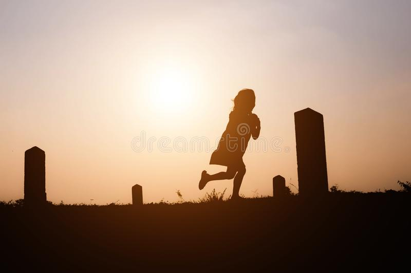 Girls are playing for fun at sunset royalty free stock image