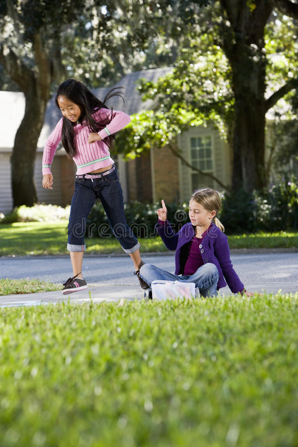 Girls Playing Hopscotch Stock Photography