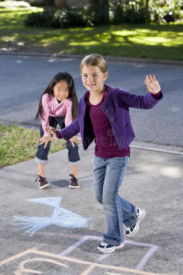 Download Girls playing hopscotch stock photo. Image of ethnicity - 16899518