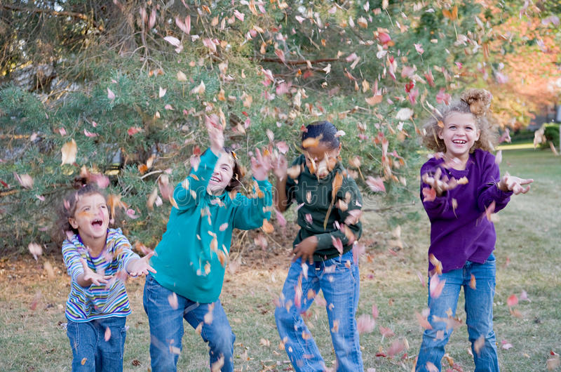 Girls Playing in Leaves stock images