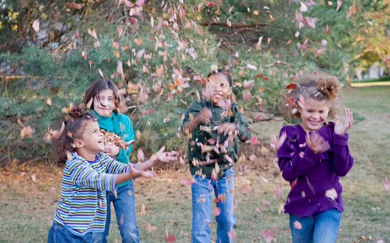 Girls Playing in Leaves royalty free stock photos