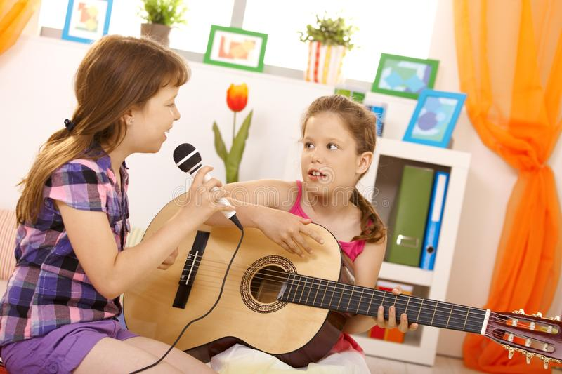 Girls Playing Music And Singing Stock Photo