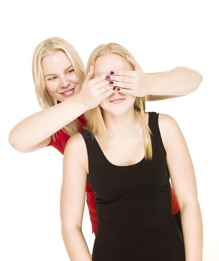 Girls playing Peek-a-boo stock image