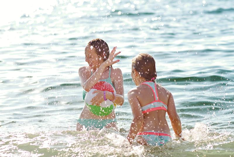 Girls playing in sea royalty free stock photo