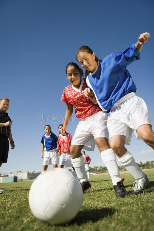 Girls Playing Soccer. Low angle view of girls playing soccer royalty free stock photography