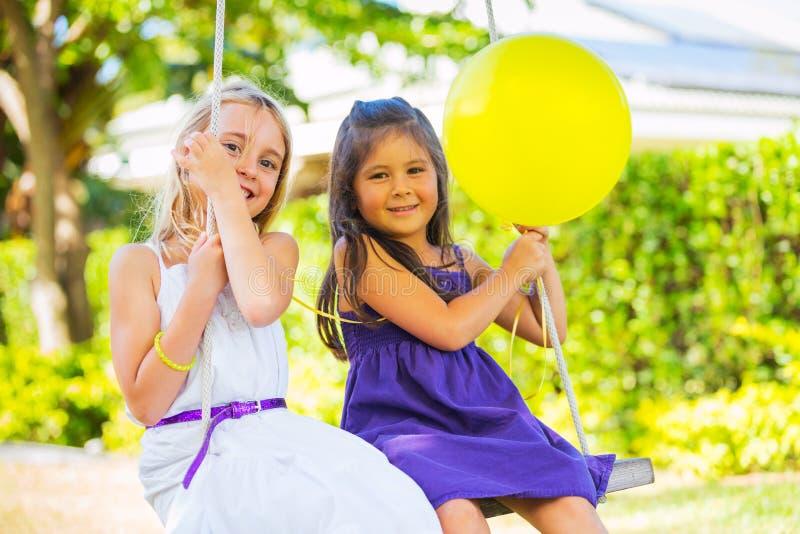 Girls Playing on Swing stock photos