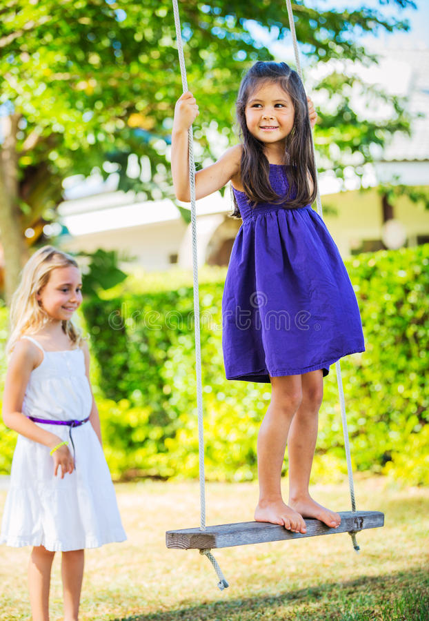Girls Playing on Swing royalty free stock photo