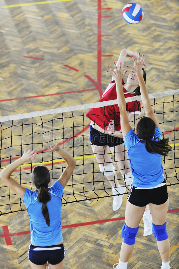 Girls playing volleyball indoor game royalty free stock photography