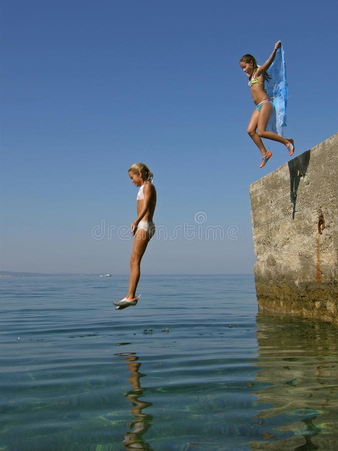 Girls plung in sea stock photos