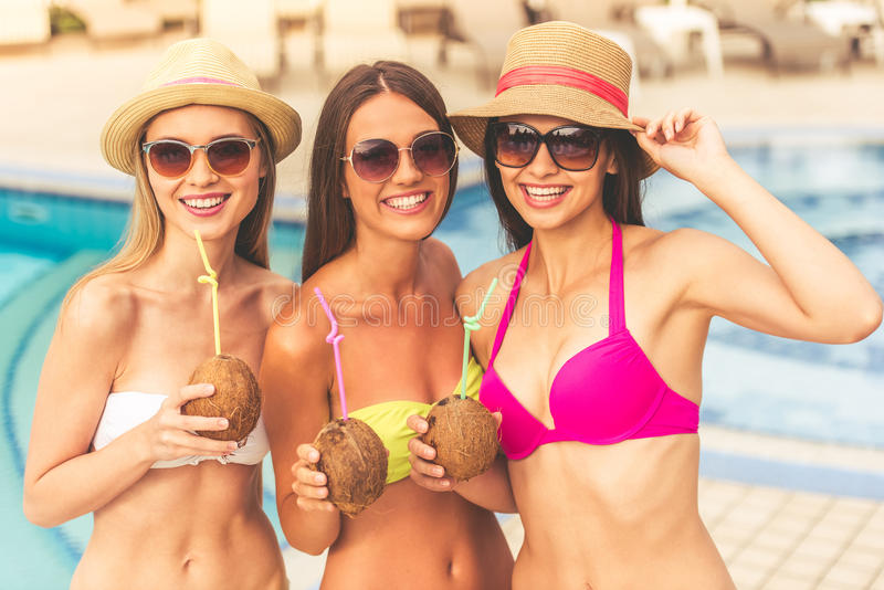 Girls at the pool royalty free stock photography