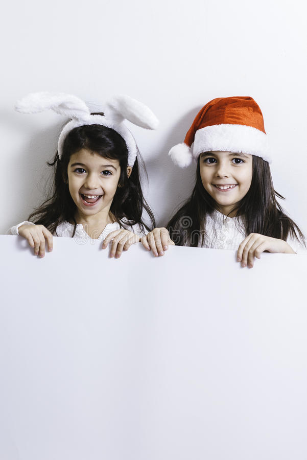 Girls posing for Christmas and New Year holidays stock image