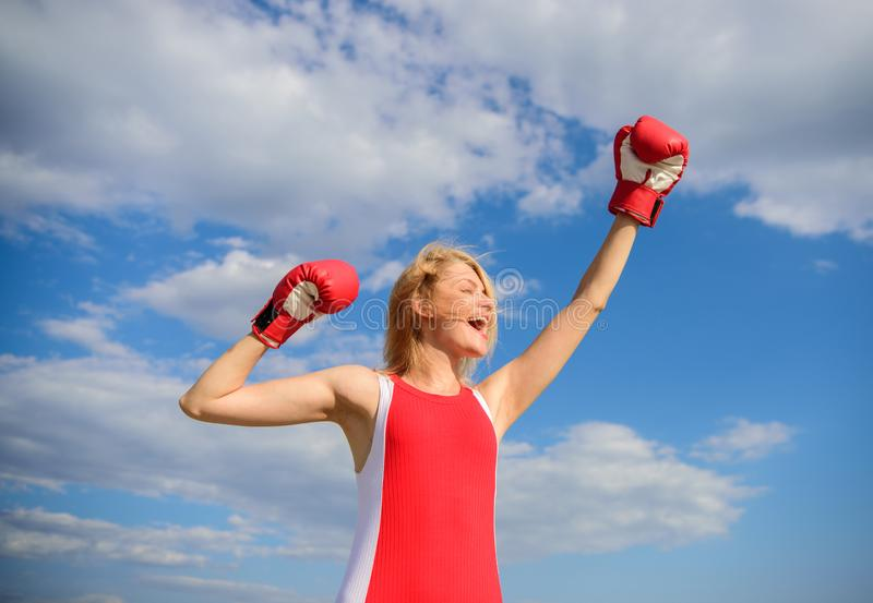 Girls power concept. Woman strong boxing gloves raise hands blue sky background. Girl boxing gloves symbol struggle for. Female rights and liberties. Feminism royalty free stock images