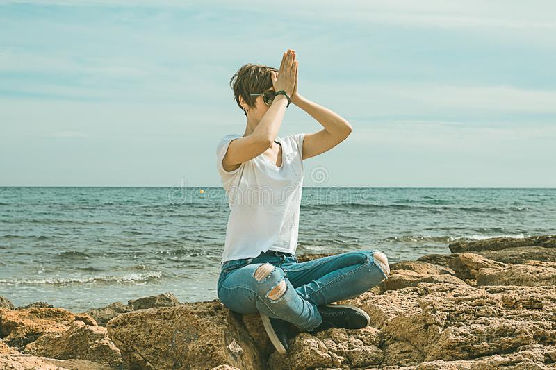 Girls practicing yoga poses on the beach. Healthy Lifestyle stock images