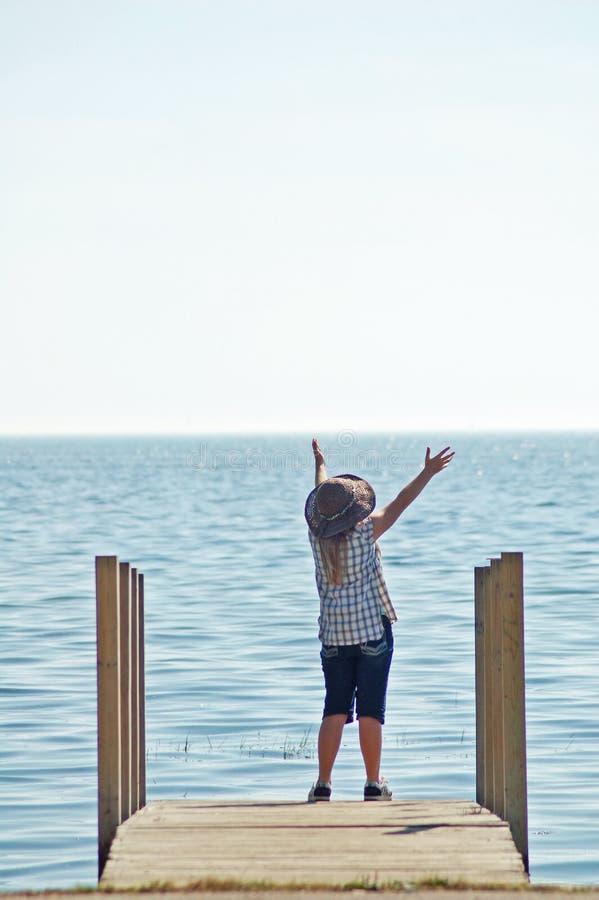 Download Girls Praising God On Dock stock photo. Image of adore - 31927260