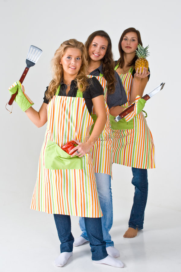 Girls preparing to grill food royalty free stock images
