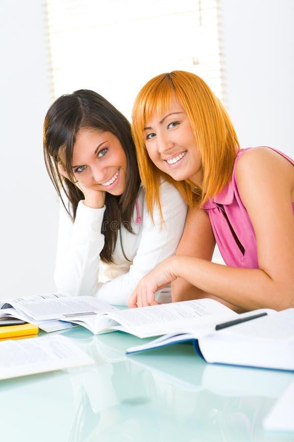 Girls preparing to lesson stock photo